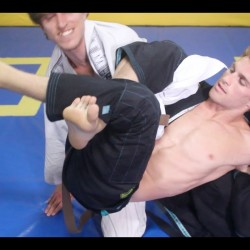 Clark Gracie shows a slick shoulder lock from the omoplata